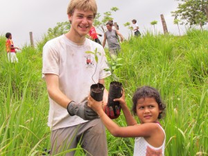 Change the World Kid and a local Costa Rican kid help plant trees